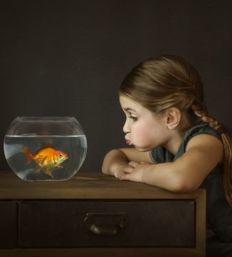 portrait of girl with her pet goldfish