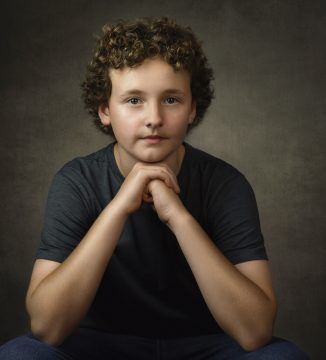 portrait of young teenage boy with curly hair