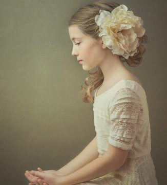 Alana Lee Photography: portrait of young girl with flower in hair and hands folded on lap