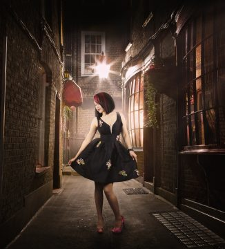 image of beautiful lady in old cobblestone alley