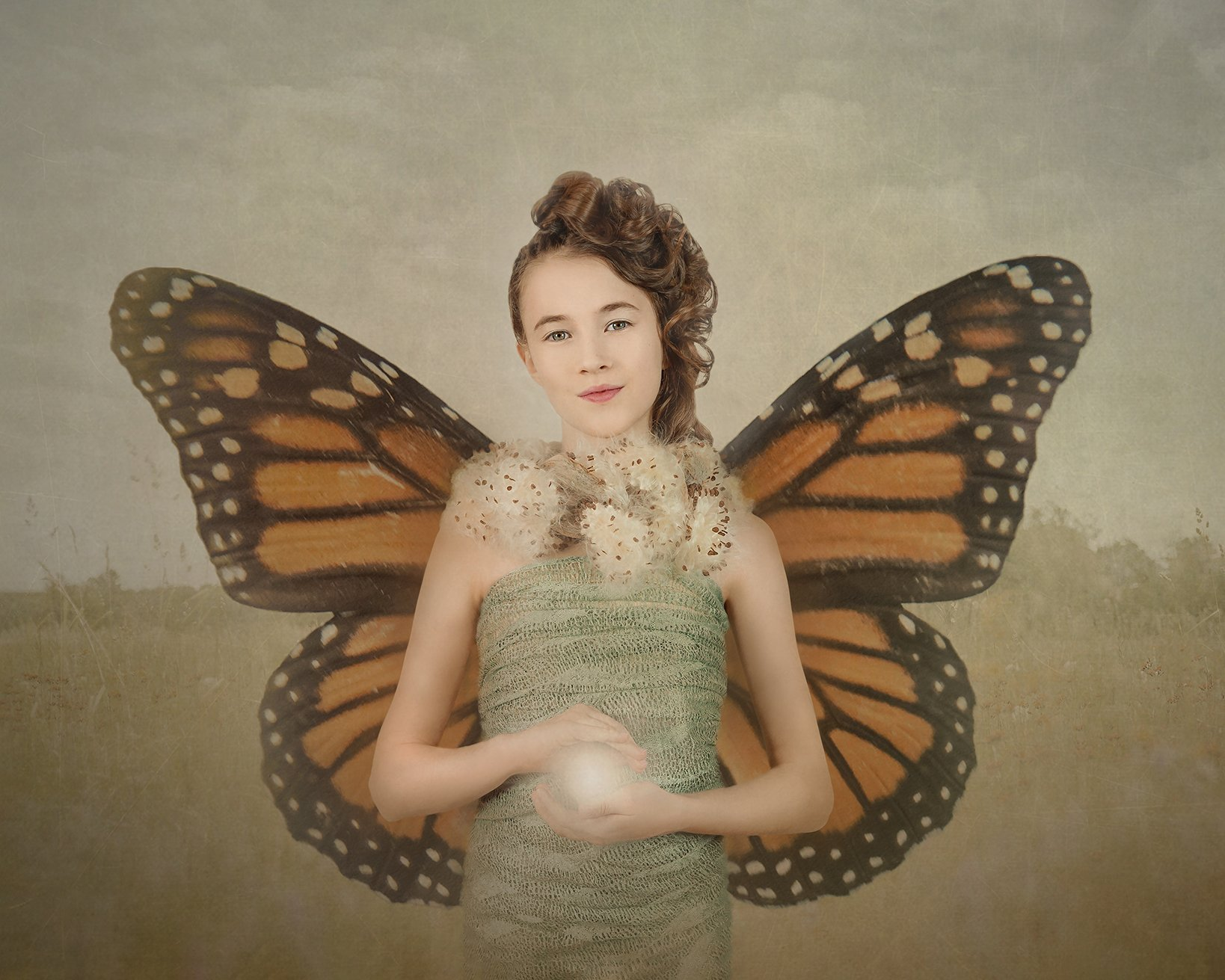 Texture overlay added to a portrait of a girl with monarch butterfly wings