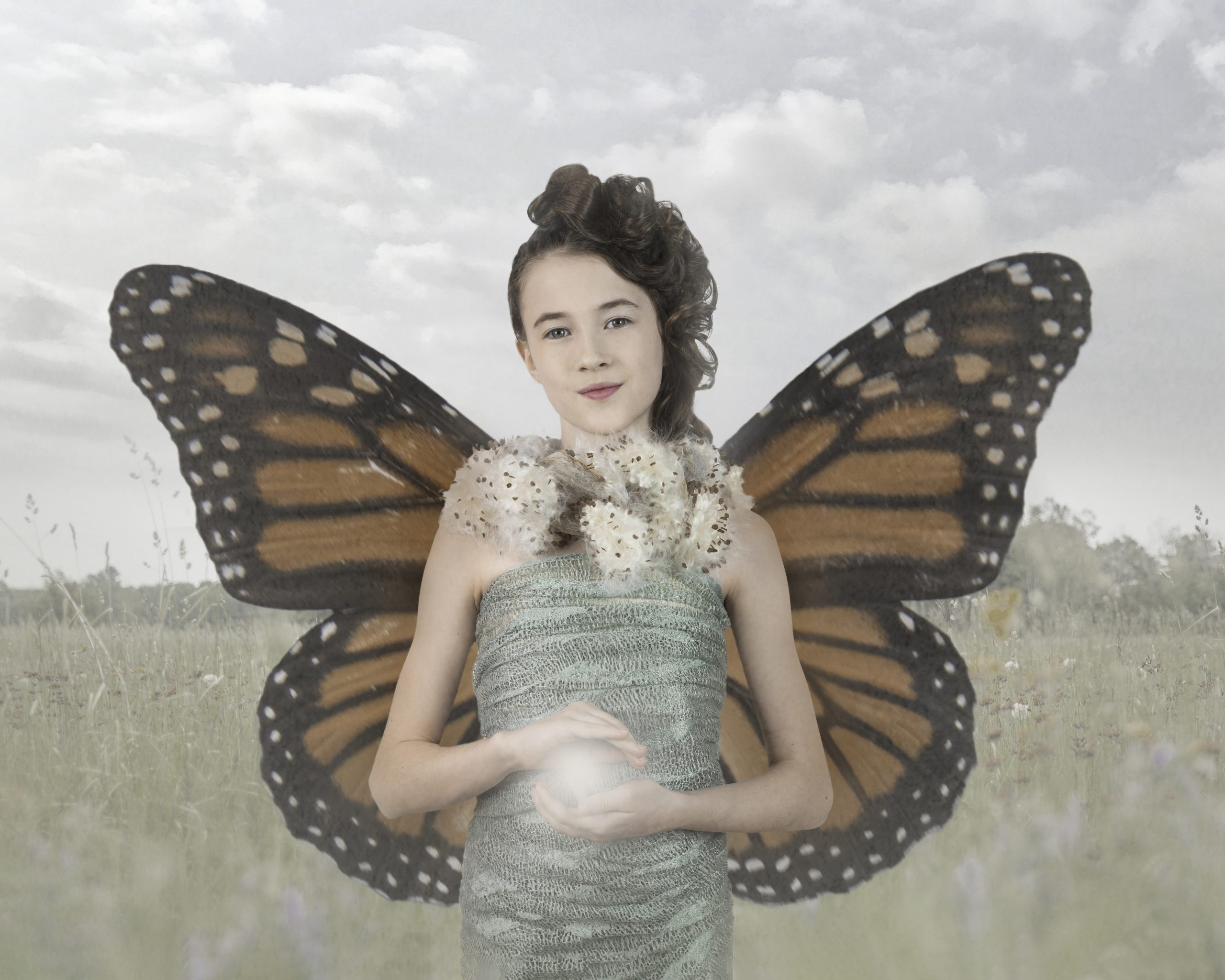 Before and after slider showing Texture overlay added to a portrait of a girl with monarch butterfly wings
