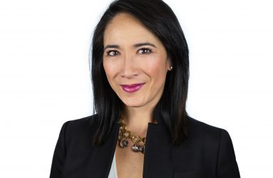 headshot of asian woman in business suit